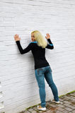 The girl costs about a white wall Stock Photo