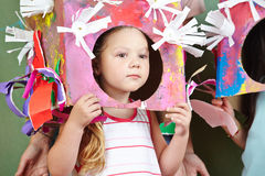 Girl with costume for carnival. Girl with selfmade costume for carnival in a kindergarten stock image