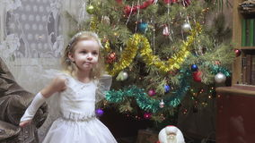 Girl in costume at Christmas tree stock footage