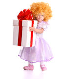 Girl in costume of doll with gift box. Isolated Royalty Free Stock Image