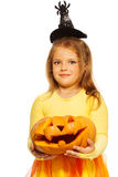 Girl in costume with Halloween pumpkin Royalty Free Stock Image