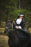 Girl in costume on horseback Royalty Free Stock Images