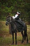 Girl in costume on horseback Stock Images