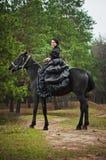 Girl in costume on horseback Royalty Free Stock Photo