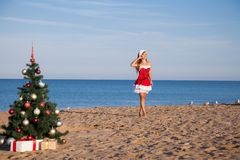 Girl on the beach on Christmas and new year at the resort. Girl in costume on the karnovalnom resort on Christmas new year Stock Images