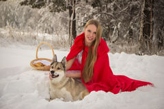 Girl in costume Little Red Riding Hood with dog like a wolf Stock Photo