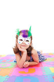 Girl in costume mask. Girl wearing colorful mask. Isolated on white Stock Photography