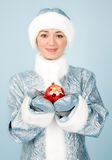 Girl in costume with new year toy Stock Image