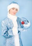 Girl in costume with new year toys stock image