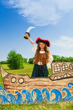 Girl in costume of pirate with black hat and sword Stock Photo