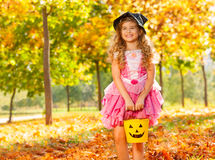 Girl in costume of princess hold small bucket Royalty Free Stock Image