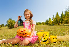 Girl in costume of princess sitting with  pumpkin Royalty Free Stock Photos