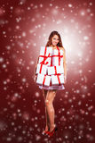 Girl in costume of Santa Claus with shopping Stock Images