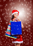 Girl in costume of Santa Claus with shopping Royalty Free Stock Photo