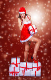 Girl in costume of Santa Claus with shopping Royalty Free Stock Photos