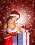 Girl in costume of Santa Claus with shopping Stock Photography