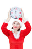 A girl in the costume santa holding watch. Royalty Free Stock Photography