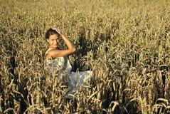Girl in costume sitting in the Rye Stock Image