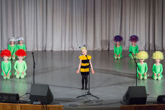 Girl in costumes  performs on stage Royalty Free Stock Photos