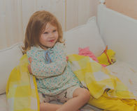 Girl in a cot does not want to sleep naughty Royalty Free Stock Photos