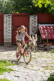 Girl in the cottage yard Royalty Free Stock Photos