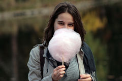 Girl with cotton candy Royalty Free Stock Photography