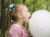 Girl and cotton candy Stock Image