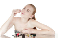 Girl with cotton swab cleaning her face. Royalty Free Stock Photography