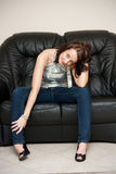 Girl on the couch Stock Images
