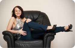 Girl on the couch Stock Photography