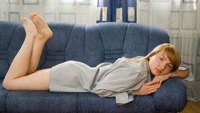 Girl on the couch Stock Photos