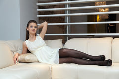 The girl on the couch Stock Image