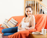 Girl on couch with mug of coffee . royalty free stock photo