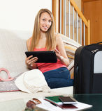 Girl on couch near baggage Stock Photography