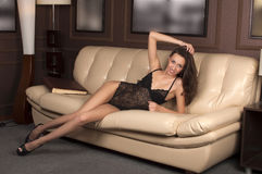 Girl on the couch royalty free stock image