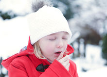 Girl coughing with flu in winter Stock Photos