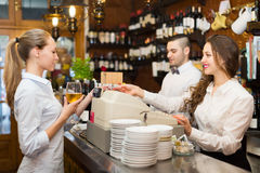 Girl at counter in bar Royalty Free Stock Images