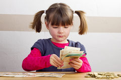 Girl is counting bank notes Royalty Free Stock Photo