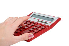 Girl counting on a calculator Royalty Free Stock Images