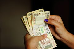 A girl counting Indian currency notes Royalty Free Stock Photos