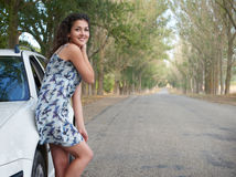 Girl on country road with car, summer season Royalty Free Stock Images