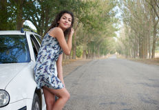Girl on country road with car, summer season Stock Photos