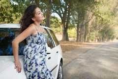 Girl on country road with car, summer season Royalty Free Stock Photos