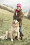 Girl on country walk with dog in winter Royalty Free Stock Photo