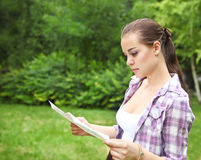 Girl in the countryside holding a map Stock Photography