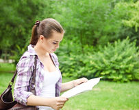 Girl in the countryside holding a map Royalty Free Stock Photography