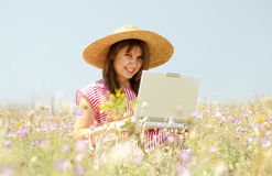 Girl at countryside with notebook. Royalty Free Stock Photo