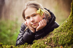 Girl in countryside. Portrait of thoughtful girl in countryside with flower in hair Royalty Free Stock Images