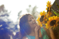 Girl in the countryside with sunflowers Royalty Free Stock Images
