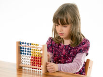 A girl counts with abacus Royalty Free Stock Photos